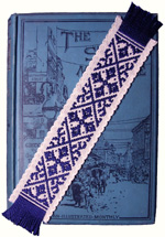 Compass Rose Stitchery bookmark on Strand bound volume