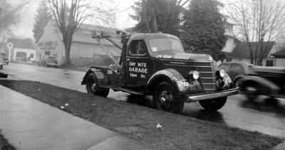 Day-Nite Garage tow truck, rainy day, Eugene, Oregon 1940