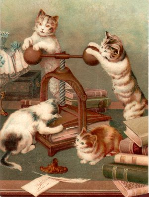 Cats using hand book-press